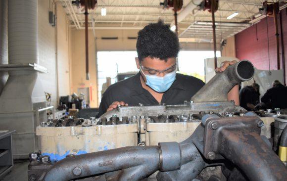 CCCTC Diesel Repair Students Using Valve Knowledge on Diesel Engines